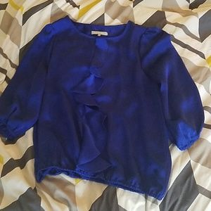 Blue shimmery blouse with ruffle